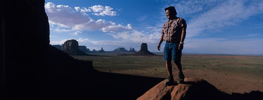 USA, Arizona, Monument Valley Navajo Tribal Park, Navajo Indian Richard Frank leads tour group through Monument Valley