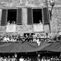 All the balcony in the Piazza del campo are crowded of people before the race