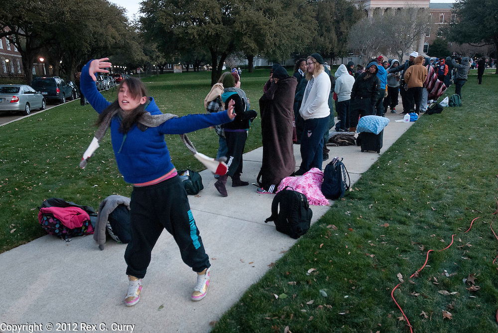 """Emily Tsuknekawa, 22, from Sacramento, Ca. dances while waiting in the early morning cold to audition for """"So You Think You Can Dance"""" at SMU on Friday, Jan. 13, 2012."""