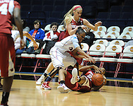 "Arkansas' Calli Berna (11), Arkansas' Dominique Robinson (21) and Ole Miss' Valencia McFarland (3) go for the ball at the C.M. ""Tad"" Smith Coliseum in Oxford, Miss. on Thursday, January 12, 2012."