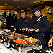 Medford Firefighters get lunch at Carmichael Dining Hall at Tufts's annual Chili Fest, an event sponsored by Dining.Services for local Medford and Somerville firefighters and police officers. (Alonso Nichols/Tufts University)