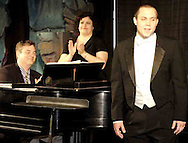 WSU Professors Steven Aldredge (left) Diana Cataldi applaud Sophomore Mitch Rowe after a performance at the 2007 Arts Gala at Wright State University, Saturday evening..