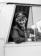 Joan Doran of Ballyfermot, Dublin, CI&Eacute;&rsquo;s first-ever female bus driver, photographed at Phibsborough Garage, Dublin, as she sets off on her first round. <br />2 May 1980