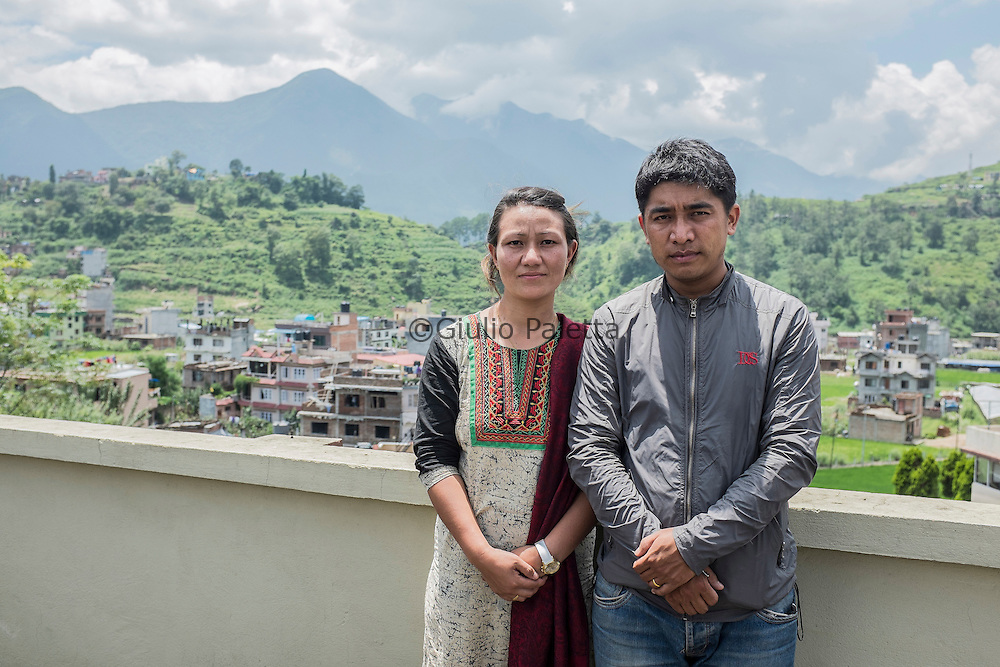 Kalplana Blon, whose mother, Chinimaya, 62 years old was arrested at the end of June with the accusaton of human trafficking and trying to converte the group of orfans she was taking care of. Here portraited with her husband at Pastor Tanka office in Patan, Kathmandu, Nepal