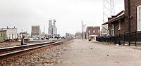 18 wheeler truck crossing railroad tracks near the historic train station in downtown Brinkley Arkansas.