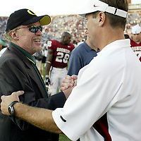 Oregon Ducks football team in Oklahoma for game against against the Sooners..Phil Knight, Nike CEO, who furnishes both the Ducks and the Sooners with equipment and clothes, left, with Oklahoma coach Bob Stoops after game..Photos © Todd Bigelow/Aurora