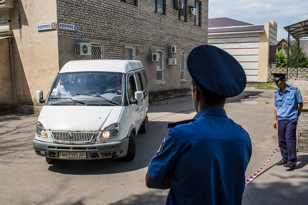 DONETSK, UKRAINE - MAY 27: An ambulance leaves a local morgue guarded by police and fighters from the self-proclaimed Donetsk People's Republic, where the bodies of dozens of fighters killed were taken following a violent battle for control of the local airport the previous day, on May 27, 2014 in Donetsk, Ukraine. After businessman Petro Poroshenko won Sunday's presidential election in Ukraine, the military has been cracking down on pro-Russian separatist fighters. (Photo by Brendan Hoffman/Getty Images) *** Local Caption ***