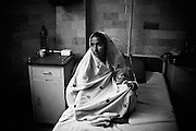 A 20 year old young woman from Balochistan waits for her fistula repair operation in the Koohi Goth Womens hospital. During the delivery of her 3rd baby that was stillborn, she develloped fistula. Koohi Goth Womens hospital, Karachi, Pakistan, 2010