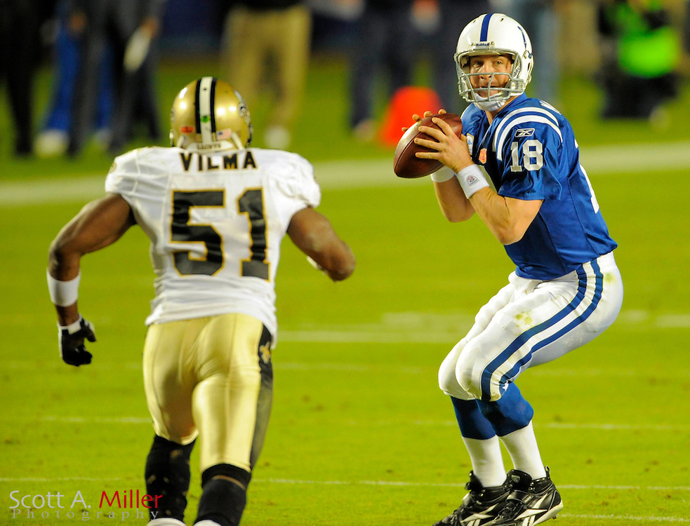 Feb 7, 2010; Miami, FL, USA; Indianapolis Colts quarterback Peyton Manning (18) is pressured by New Orleans Saints linebacker Jonathan Vilma (51) during the first quarter of Super Bowl XLIV at Sun Life Stadium. ©2010 Scott A. Miller