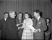 20/03/1959<br /> 03/20/1959<br /> 20 March 1959<br /> Gael Linn singing competition and concert at Dungannon, Co. Tyrone. <br /> Very Rev. Dean Quinn, P.P., Dungannon (left) presenting Miss Margaret Dynes, Church Street, Dungannon, with the 1st Prize of &pound;10 in the Gael Linn Competition held in St. Patrick's Hall, Dungannon. Included are Seamus O'Gairbhshoin, Secretary of Dungannon Drama festival, and the National Organiser for Gael-Linn, Diarmuid O'Broin, (right).