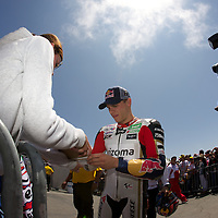 LCR Honda rider Stefan Bradl of Germany signs an autograph before the  Qualifying practice session for the U.S. MotoGP at Mazda Raceway Laguna Seca, Saturday, July 28, 2012.
