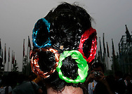 A Chinese hostess wears Olympic rings in her hair during the opening ceremony for the Athletes village in Beijing , China, Sunday, July, 27, 2008.