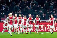 AMSTERDAM - Ajax - ADO , Voetbal , Eredivisie , Seizoen 2016/2017 , Amsterdam ArenA , 29-01-2017 ,  eindstand 3-0 , Spelers van Ajax lopen terug na het vieren van de 2-0 van Ajax speler Lasse Schone (2e r)