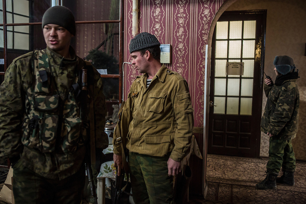 GORLOVKA, UKRAINE - JANUARY 31, 2015: Rebel fighters relax inside a house in which they live behind a front-line position in Gorlovka, Ukraine. Fighting in Ukraine has intensified over the last week, with rebels declaring the end of a September ceasefire. CREDIT: Brendan Hoffman for The New York Times