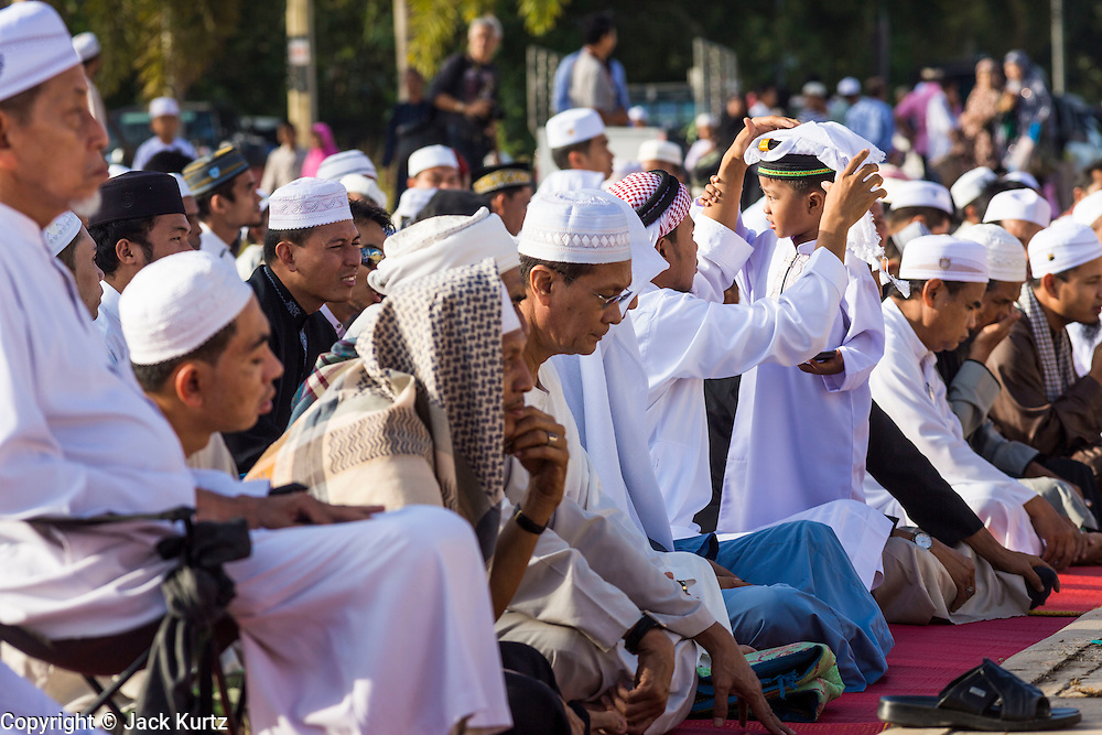 Men and male children wait for Eid services to start at Songkhla Central Mosque in Songkhla province of Thailand. Eid al-Fitr is also called Feast of Breaking the Fast, the Sugar Feast, Bayram (Bajram), the Sweet Festival and the Lesser Eid, is an important Muslim holiday that marks the end of Ramadan, the Islamic holy month of fasting.