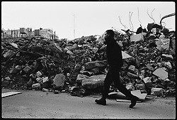 A Palestinian man walks past rubble from a building destroyed the day earlier by Israeli forces during a raid into the city of Nablus in the occupied West Bank.