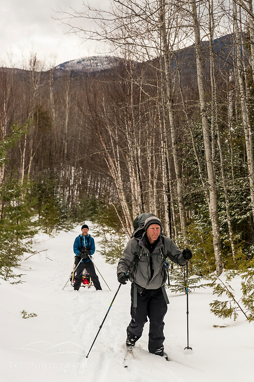 Two men cross country skiing in Maine's Katahdin Woods and Waters National Monument.