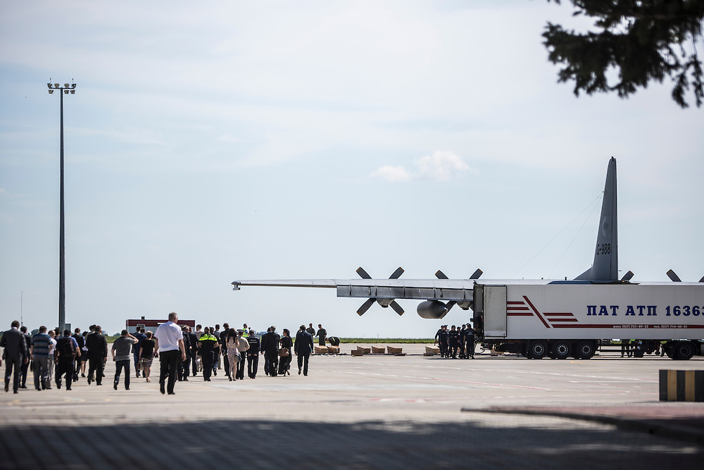 KHARKIV, UKRAINE - JULY 23: Coffins containing the bodies of victims of the crash of Malaysia Airlines flight MH17 are prepared for loading onto a plane which will take them to the Netherlands on July 23, 2014 in Kharkiv, Ukraine. Malaysia Airlines flight MH17 was travelling from Amsterdam to Kuala Lumpur when it crashed killing all 298 on board including 80 children. The aircraft was allegedly shot down by a missile and investigations continue over the perpetrators of the attack. (Photo by Brendan Hoffman/Getty Images) *** Local Caption ***