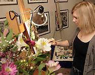 WSU Senior Bethany Booth, from Englewood, works on a painting at the 2007 Arts Gala at Wright State University, Saturday evening..