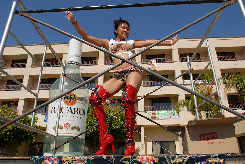 A gogo dancer performs on a platform at the L Word pool party hosted by lesbian party promoter Mariah Hanson's Club Skirts company at the Doral Desert Princess Resort in Cathedral City, California (just outside of Palm Springs), on April 1, 2007, the last of five days of parties at the Dinah Shore weekend, the annual lesbian gathering run simultaneously with the Kraft-Nabisco Championship LPGA golf tournament. .