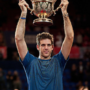 Basel, Switzerland. 27th Oct, 2013. J.M. Del Potro (ARG) raises trophy of the Swiss Indoors at St. Jakobshalle on Sunday. Photo: Miroslav Dakov/ Alamy Live News