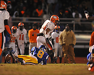 Oxford High's Harland Stewart (8) forces a fumble by Jackson Callaway's Jabari Woodcox (24) and recovers it in a MHSAA North 5A playoff game in Oxford, Miss. on Friday, November 29, 2013. Oxford won 23-7 to advance to the Class 5A championship game against Picayune.