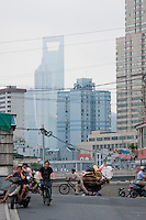 people cycling and carrying loads in Shanghai China