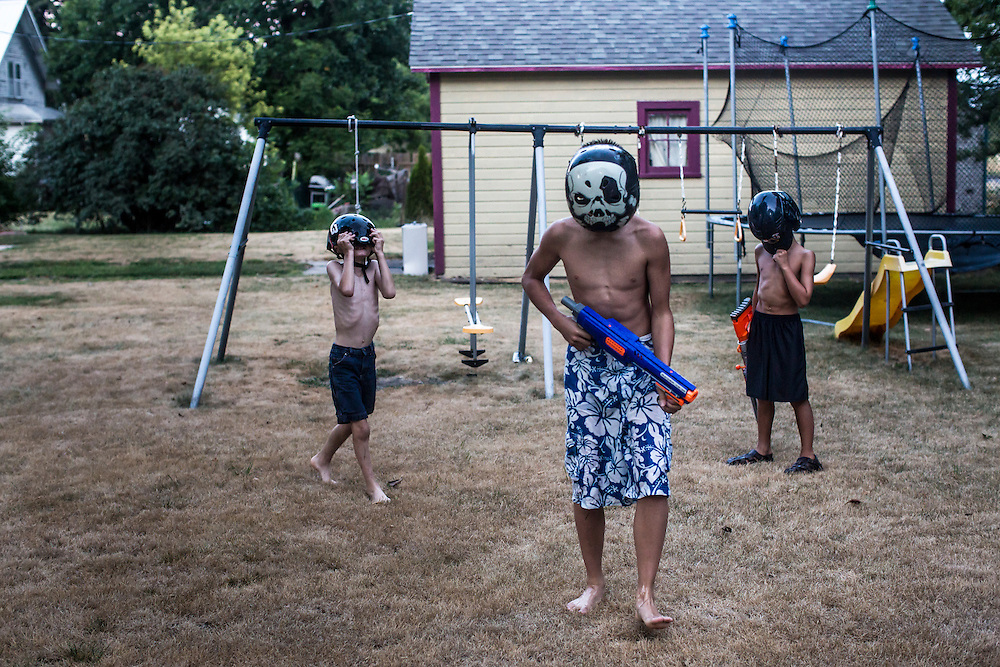 Jesse Hubbard, James Hill, and Reese Jensen play with toy guns on Tuesday, July 17, 2012 in Webster City, IA.