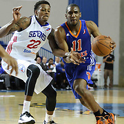 Westchester Knicks Guard Langston Galloway (11) dribbles past Delaware 87ers Guard Jamal Jones (22) in the first half of a NBA D-league regular season basketball game between the Delaware 87ers and the Westchester Knicks (New York Knicks) Sunday, Dec. 28, 2014 at The Bob Carpenter Sports Convocation Center in Newark, DEL