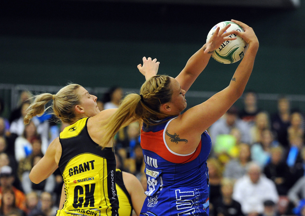 Mystics' Cathrine Latu takes the ball under pressure from Pulse's Katrina Grant in the ANZ Championship netball, Arena Manawatu, Palmerston North, New Zealand, Sunday, May 18, 2014. Credit:SNPA / Ross Setford