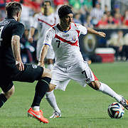 Costa Rica Midfielders Christian Bolanos (7) attempts to pass the ball as Republic of Ireland Defender Richard Keogh (4) defends in the second half of the inaugural freedom cup between Ireland and Costa Rica Friday. June. 6, 2014 at PPL Park in Chester PA.