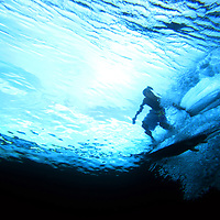 Underwater view of surfing in the Mentawai Islands.
