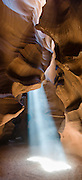 "A ray of sunlight pierces Upper Antelope Canyon, near Page, Arizona, USA. Antelope Canyon Navaho Tribal Park. Panorama stitched from three overlapping images. Published in ""Light Travel: Photography on the Go"" book by Tom Dempsey 2009, 2010."