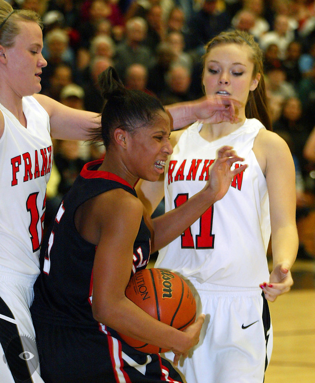 03/05/2010 - Clackamas' Deeshyra Thomas (5) fights for some room to  pass while boxed in by Franklin's Katie Skinner (12) and Marin Hobson (11).  Franklin beat Clackamas 66-57.