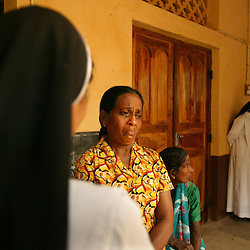 A woman, who lost her husband, two children and mother in the tsunami, cries to a nun at St. CeciliaÕs Convent, Batticaloa, Sri Lanka, Jan. 16, 2005. Residents of the small Christian village Dutch Bar spent more than six weeks in a makeshift refugee camp at the local convent recovering from the devastating tsunami that hit the eastern and southern borders of Sri Lanka. They were then moved into another temporary living camp, while awaiting the building of new homes.