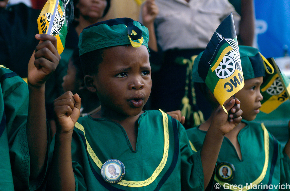 A young boy holds up ANC flags and is dressed in ANC attire at a rally in 1994 where Nelson Mandela appeared in the run up to the first democratioc elections in South Africa.