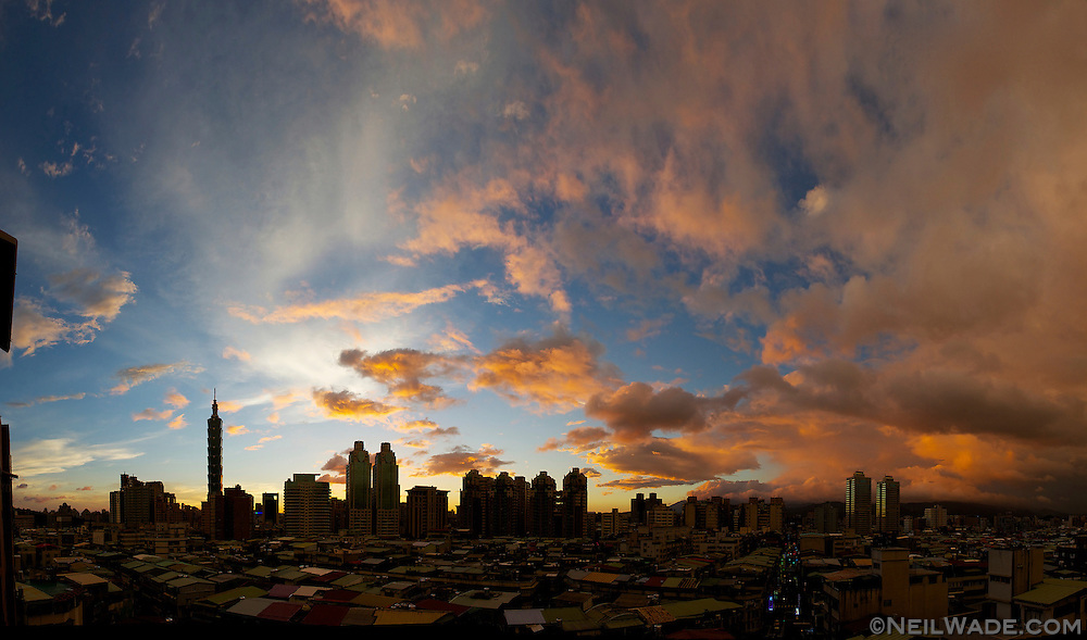 A dramatic sunset over Taipei 101 and the Taipei City Skyline.