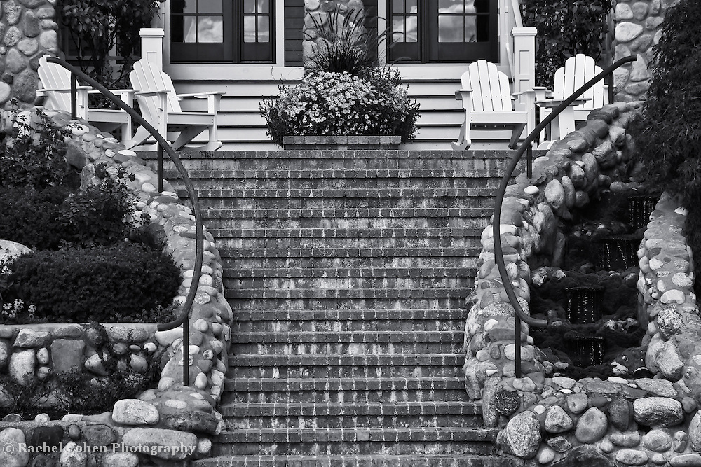 &quot;The Setting&quot;<br /> <br /> This image is a black and white semi-symmetrical view of lovely set of  stairs, a porch and a sitting area in the quiet town of Bay Harbor!<br /> <br /> Black and White Images by Rachel Cohen