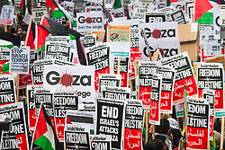 Kesnington, London, July 11th 2014. A densely packed sea of placards as thousands of Palestinians and their supporters demonstrate against the latest wave of Israeli retaliatory attacks on Palestinian targets and homes, where casualties are steadily mounting.