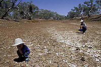 Drought -Winton Queensland for the Observer Magazine. Mark Hinman and Son Thomas on the bank of Combo Water hole.