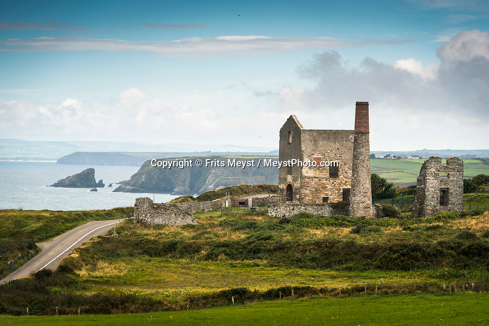 Southern Ireland, August 2016.  The Copper Coast UNESCO Global Geopark and Visitor Centre is located on the South East coast of Ireland, between Tramore and Dungarvan in County Waterford. It extends between Fenor in the east to Stradbally in the west and up to Dunhill in the north. The area was declared a European Geopark in 2001. In 2015 Waterford's The Copper Coast Geopark, has become a UNESCO Global Geopark.  The Copper Coast gets its name from the 19th Century copper mines that lie at its heart. It comprises some 25 kilometres of spectacular coastline consisting of scalloped beaches and coves buttressed and enclosed by rocky headlands. Oceans, volcanoes, deserts and ice sheets all combined to create the rocks, which provide the physical foundation of the natural and cultural landscapes of the Copper Coast. A coastal road trip from Kilkenny to Cork via Wexford and Waterford.  Photo by Frits Meyst / MeystPhoto.com