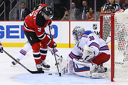 Oct 21, 2014; Newark, NJ, USA; New Jersey Devils defenseman Marek Zidlicky (2) looks for the loose puck after a save by New York Rangers goalie Henrik Lundqvist (30) during the second period at Prudential Center.