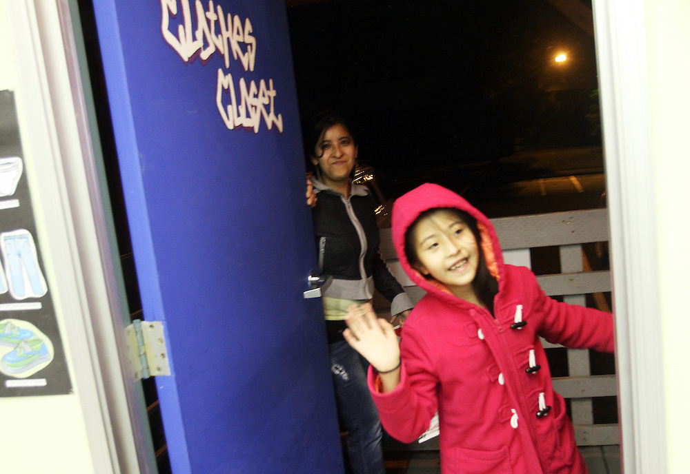 Galilea Muñiz leaves with her mother, Dulce Lopez. The Beaverton School District has a Clothes Closet for students in need. Photographed Wednesday, Jan. 25, 2011.