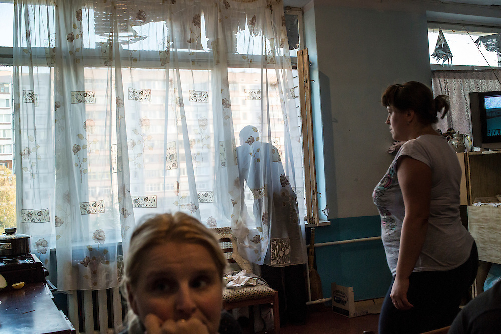 DNIPRODZERZHINSK, UKRAINE - OCTOBER 11: Lena, Sergiy Nebaba, and Maryna (L-R) in a makeshift kitchen at the sports school where they live with about 60 other displaced people from Eastern Ukraine on October 11, 2014 in Dniprodzerzhinsk, Ukraine. The United Nations has registered more than 360,000 people who have been forced to leave their homes due to fighting in the East, though the true number is believed to be much higher.(Photo by Brendan Hoffman/Getty Images) *** Local Caption ***