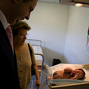 29 November 2008, Alexandra, South Africa. Ivan Lewis, UK Minister for International Development and Barbara Hogan, Minister of Health, SA. Ivan Lewis announced a new multi-million pound support package to help the country prevent millions of new HIV infections. The baby in the picture is only a few minutes old.