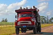 Truck hauling men in Baragua, Ciego de Avila Province, Cuba.