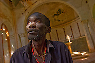 Paustino Jada, cathechist of the church in Palotaka, Sudan.  During the war he was captured by the LRA, Lord's Resistance army and tortured.  He finally escaped and returned home