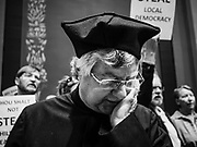 """04 MAY 2017 - ST. PAUL, MN: A Protestant minister prays during a rally supporting workers and women's rights in front of the Minnesota State Senate. About 200 people participated in a """"ISAIAH's 100 Days of Prophetic Resistance"""" rally at the Minnesota State Capitol in St. Paul. They represented churches from across the Twin Cities and were demonstrating in favor of paid sick leave, child care, and a higher minimum wage. The Twin Cities are more liberal than rural Minnesota and many Twin Cities municipalities have passed ordinances with paid sick leave, child care and higher minimum wages. Republican legislators from rural Minnesota have tried to pass laws in the legislature rolling back those ordinances.     PHOTO BY JACK KURTZ"""