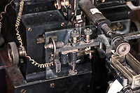 Part of the siphon recorder device. The inkwell is to the lower right. A galvanometer reacted to the plus and minus signal to move a glass pen for dash and dots. A hollow glass tube would siphon the ink from the well to the paper