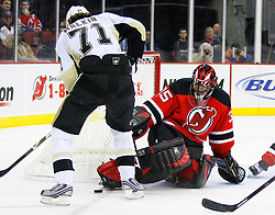 Dec 10, 2008; Newark, NJ, USA; \tod35n\ makes a save on Pittsburgh Penguins center Evgeni Malkin (71) during the first period at the Prudential Center.